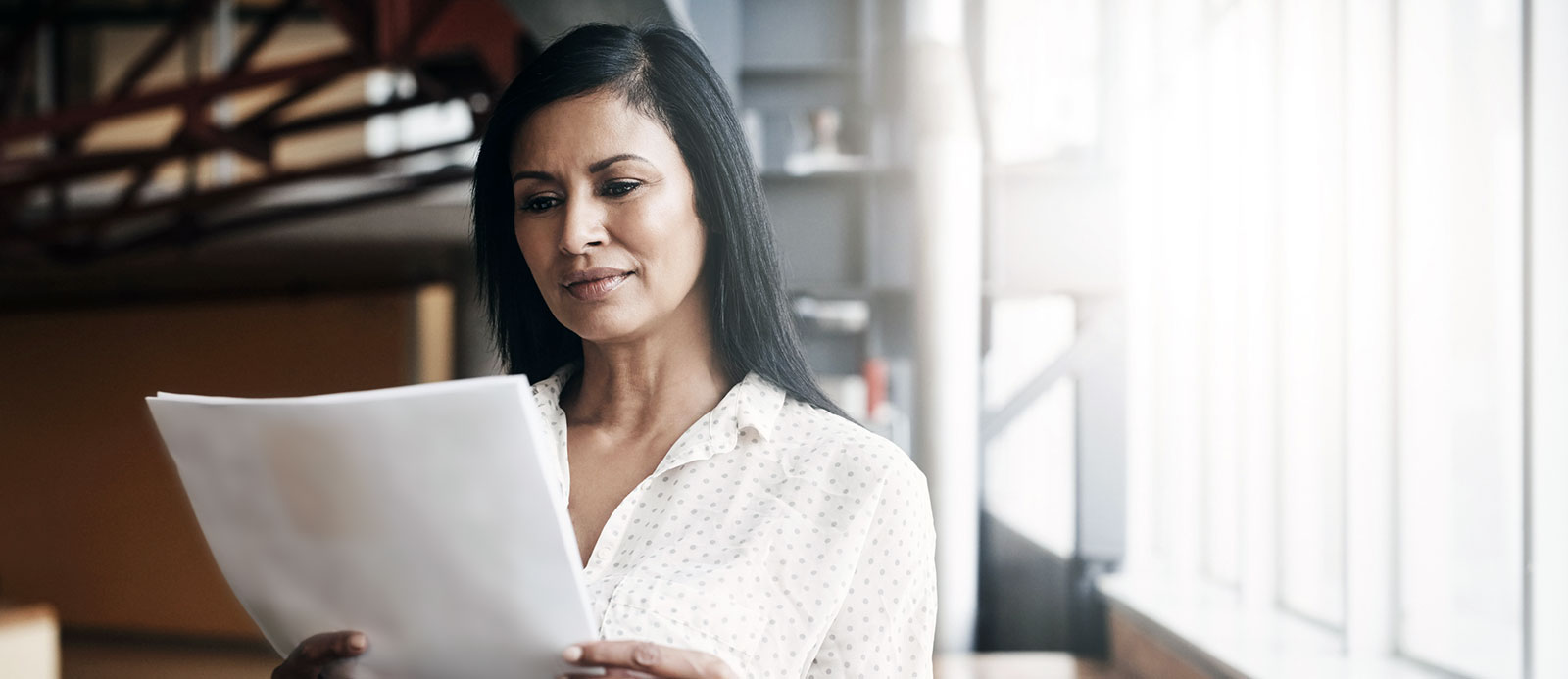 Businesswoman looking at documents